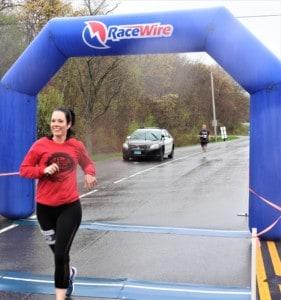 a woman finishing a race