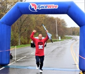 a man finishing the race with an umbrella