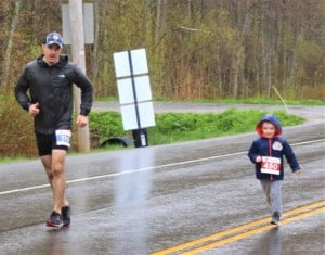 a man and a young boy running a race