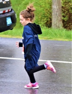 a young girl running a race