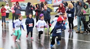 kids running a race in the rain