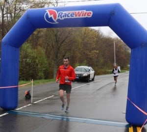a man crossing the finish line