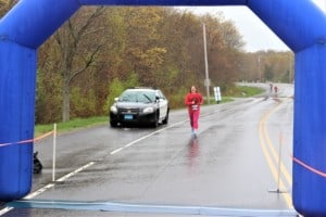a woman almost crossing the finish line