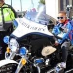 a young boy on a police motorcycle