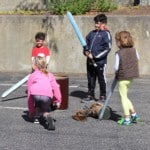 kids playing with toy swords