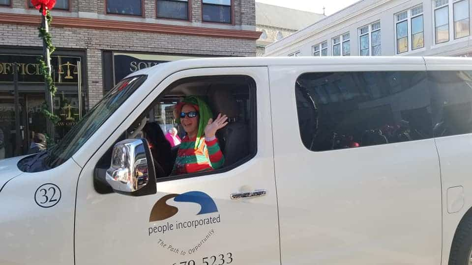 woman driving a People Incorporated white van