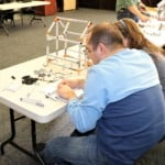 two people building with Legos