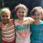 three young girls that played in colorful paint