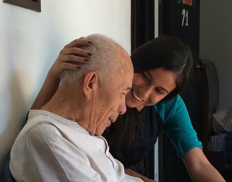 a younger woman and a senior citizen
